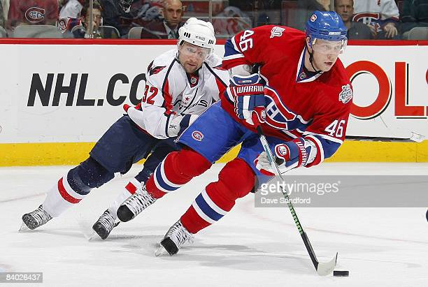 Michael Nylander of the Washington Capitals skates after Andrei Kostitsyn of the Montreal Canadiens during their NHL game at the Bell Centre December...