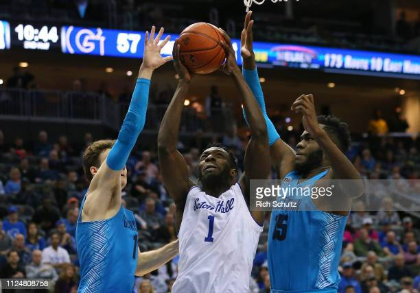 Michael Nzei of the Seton Hall Pirates attempts a shot as Greg Malinowski and Jessie Govan of the Georgetown Hoyas defend during the second half of a...