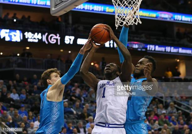 Michael Nzei of the Seton Hall Pirates in action against Greg Malinowski and Jessie Govan of the Georgetown Hoyas during a game at Prudential Center...