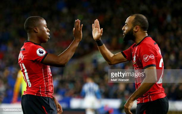 Michael Obafemi and Nathan Redmond of Southampton celebrate during the Premier League match between Huddersfield Town and Southampton FC at John...