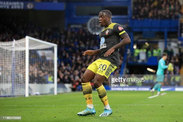 Michael Obafemi of Southampton celebrates after scoring his team's first goal during the Premier League match between Chelsea FC and Southampton FC...
