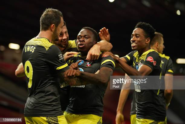 Michael Obafemi of Southampton celebrates with teammates after scoring his team's second goal during the Premier League match between Manchester...