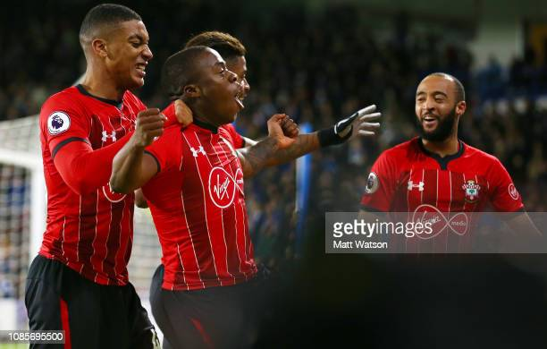 Michael Obafemi of Southampton celebrates with Yan Valery and Nathan Redmondduring the Premier League match between Huddersfield Town and Southampton...