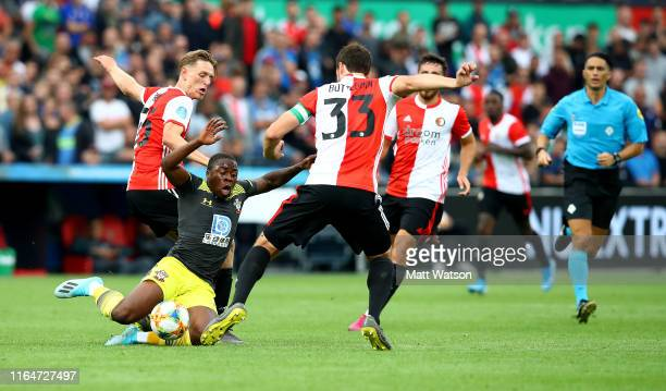Michael Obafemi of Southampton is brought down by Wouter Burgerduring the pre season friendly match between Feyenoord and Southampton FC at De Kuip...