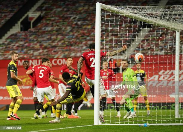 Michael Obafemi of Southampton scores his team's second goal past Victor Lindelof of Manchester United during the Premier League match between...