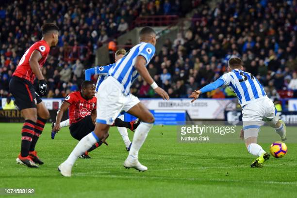 Michael Obafemi of Southampton scores his team's third goal during the Premier League match between Huddersfield Town and Southampton FC at John...