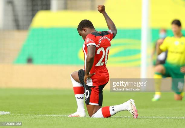 Michael Obafemi of Southampton takes a knee in support of the Black Lives Matter movement during the Premier League match between Norwich City and...