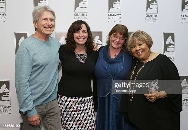Michael Ochs Executive Director of The Woody Guthrie Center Deana McCloud Meegan Ochs and singer Mavis Staples attend The Woody Guthrie Center...