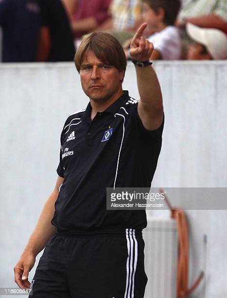 Michael Oenning head coach of Hamburg gives instructions to his team during the preseason friendly match between Hamburger SV and FC Ingolstadt 04 at...