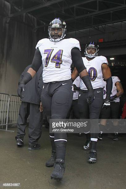 Michael Oher of the Baltimore Ravens takes the field for the game against the Cincinnati Bengals at Paul Brown Stadium on December 29 2013 in...