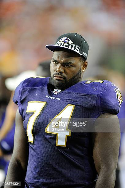 Michael Oher of the Baltimore Ravens watches the preseason game against the Washington Redskins at FedExField on August 21 2010 in Landover Maryland