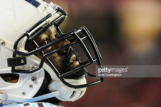 Michael Oher of the Tennessee Titans is seen on the sidelines in the first half of a preseason game against the Atlanta Falcons at the Georgia Dome...