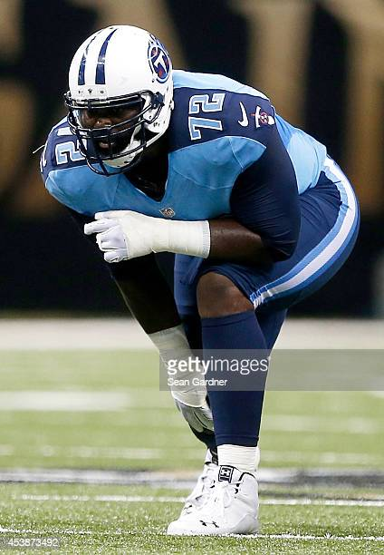 Michael Oher of the Tennessee Titans reacts to a play during a preseason game against the New Orleans Saints at the MercedesBenz Superdome on August...