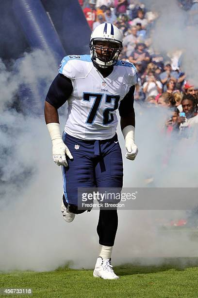 Michael Oher of the Tennessee Titans runs onto the field prior to a game against the Cleveland Browns at LP Field on October 5 2014 in Nashville...