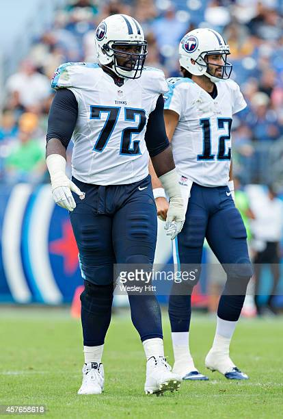 Michael Oher of the Tennessee Titans walks to the line of scrimmage during a game against the Jacksonville Jaguars at LP Field on October 12 2014 in...