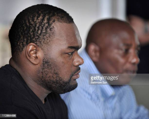 Michael Oher talks to the media after signing a five-year contract with the Baltimore Ravens in Baltimore, Maryland, Thursday, July 30, 2009.