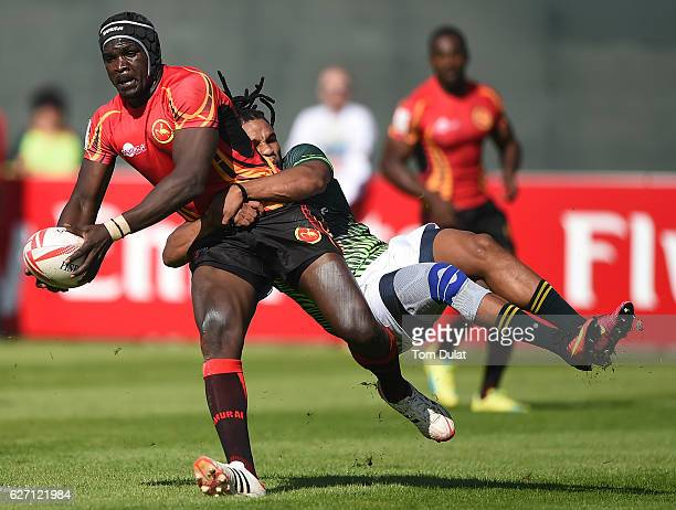 Michael Okorach of Uganda is tackled by Rosko Specman of South Africa during day two of the Emirates Dubai Rugby Sevens HSBC Sevens World Series...