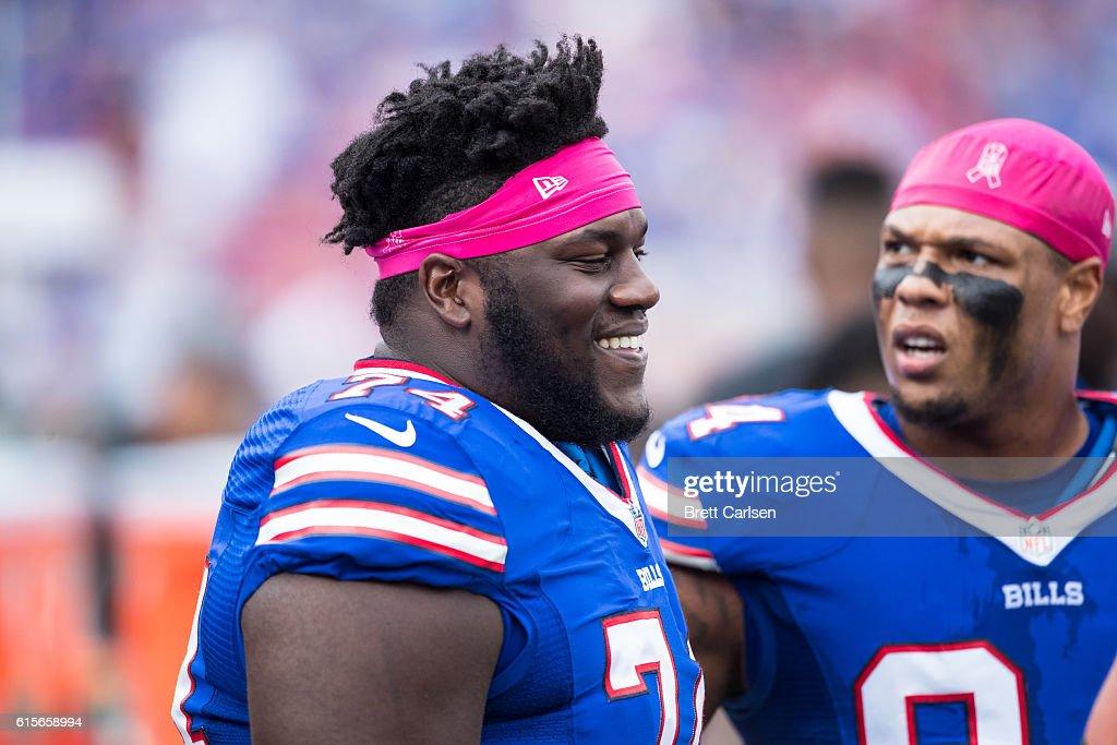 best sneakers 4e973 5289f Michael Ola of the Buffalo Bills speaks with teammates ...