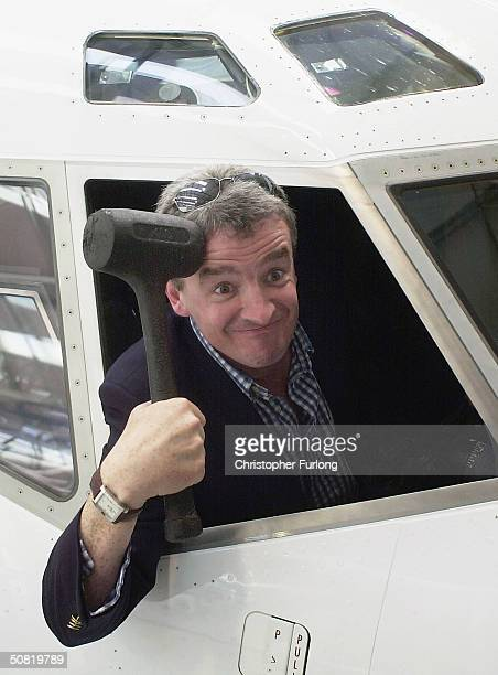 Michael O'Leary Chief Executive of low fare airline Ryanair poses for the camera during the opening of a new maintenance facility on May 10 2004 at...