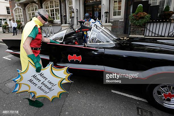 Michael O'Leary, chief executive officer of Ryanair Holdings Plc, dressed as superhero side-kick Robin gets into a replica Batmobile vehicle ahead of...