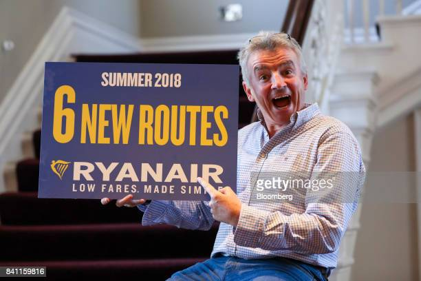 Michael O'Leary chief executive officer of Ryanair Holdings Plc poses with a sign saying '6 new routes' during a news conference in London UK on...