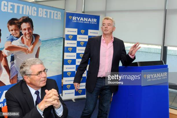 Michael O'Leary chief executive officer of Ryanair Holdings Plc right gestures ahead of the company's annual general meeting in Dublin Ireland on...