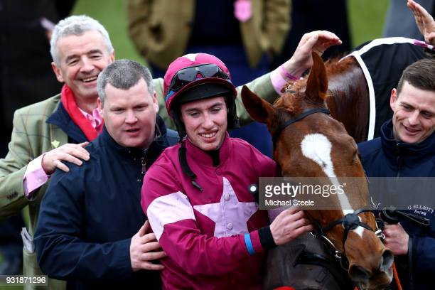 Michael O'Leary Gordon Elliott and Jack Kennedy with Samcro celebrate after winning the Ballymore Novices' Hurdle during Cheltenham Festival Ladies...