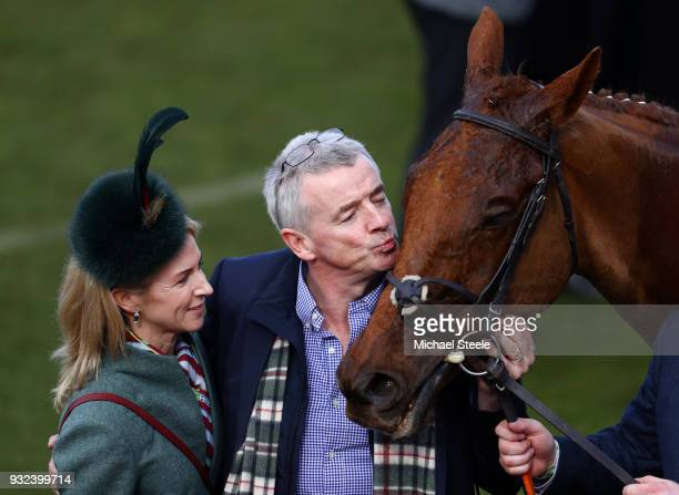 Michael O'Leary plants a kiss on the nose of Balko Des Flos after victory in the Ryanair Chase at Cheltenham Racecourse on March 15 2018 in...