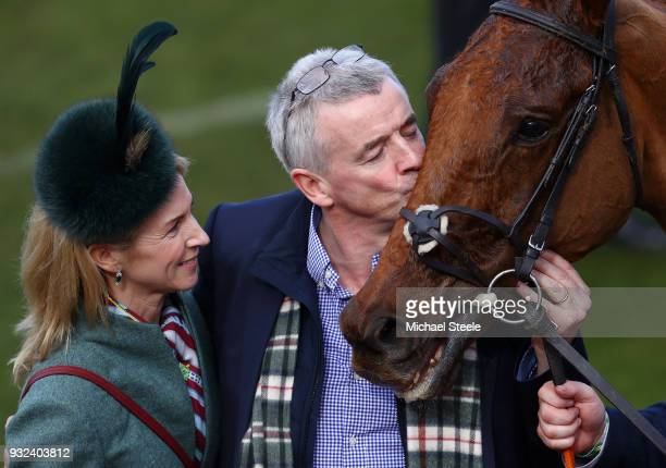 Michael O'Leary plants a kiss on the nose of Balko Des Flos as Wife Anita looks on after victory in the Ryanair Chase at Cheltenham Racecourse on...