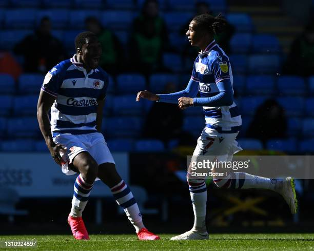 Michael Olise of Reading celebrates with team mate Yakou Meite after scoring their side's first goal during the Sky Bet Championship match between...