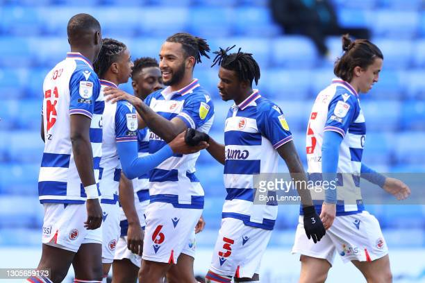 Michael Olise of Reading celebrates with teammates Lucas Eduardo Santos Joao, Liam Moore, and Omar Richards after scoring his team's first goal...