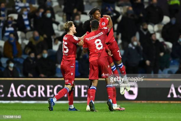Michael Olise of Reading FC celebrates with Lewis Gibson and Andy Rinomhota after scoring their team's first goal during the Sky Bet Championship...