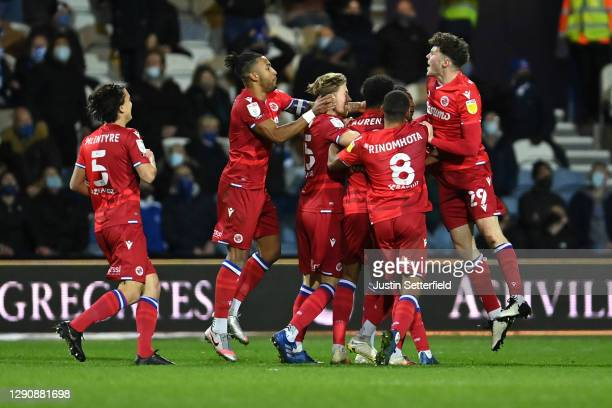 Michael Olise of Reading FC celebrates with teammates after scoring their team's first goal during the Sky Bet Championship match between Queens Park...