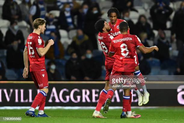 Michael Olise of Reading FC celebrates with team-mates after scoring their team's first goal during the Sky Bet Championship match between Queens...