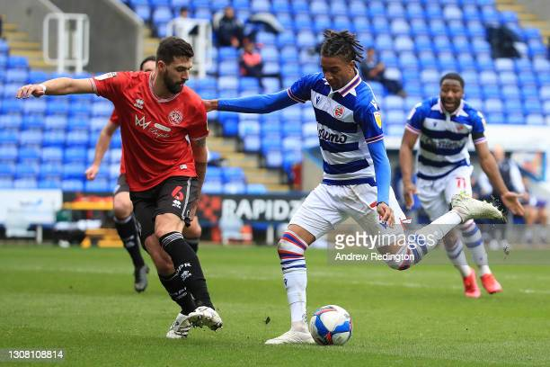 Michael Olise of Reading FC takes a shot under pressure from Yoann Barbet of Queens Park Rangers during the Sky Bet Championship match between...