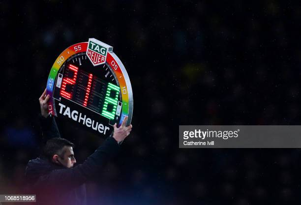 Michael Oliver holds up the Rainbow laces this is everyones game substitutes board during the Premier League match between Watford FC and Manchester...