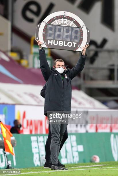 Michael Oliver the fourth official holds up the Hublot additional time board during the Premier League match between Burnley and Southampton at Turf...