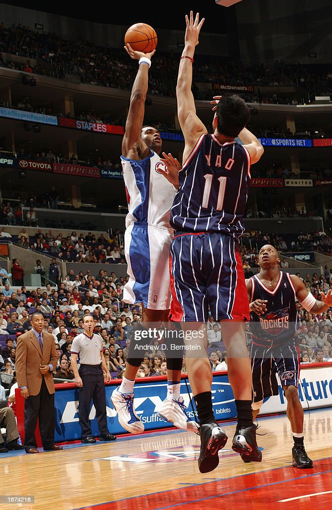 Michael Olowokandi #34 of the Los Angeles Clippers shoots over Yao Ming #11 of the Houston Rockets during the game at Staples Center on November 24, 2002 in Los Angeles, California. The Clippers won 90-89.
