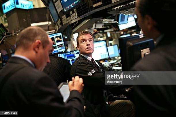 Michael O'Mara glances toward a quote screen on the floor of the New York Stock Exchange in New York US on Monday April 14 2008 Most US stocks fell...