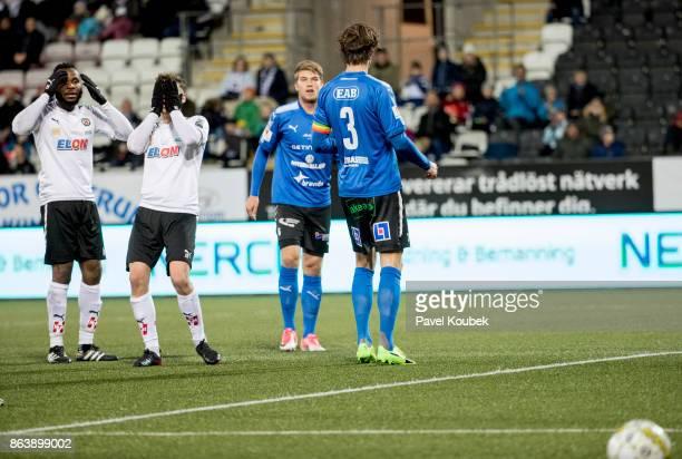 Michael Omoh & Filip Rogic of Orebro SK is dejected during the Allsvenskan match between Orebro SK and Halmstad BK at Behrn Arena on October 20, 2017...