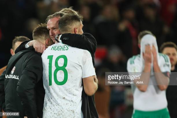 Michael ONeill head coach / manager of Northern Ireland and and Oliver Norwood of Northern Ireland and Aaron Hughes of Northern Ireland at full time...