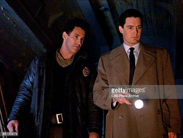 Michael Ontkean as Sheriff Harry S Truman and Kyle MacLachlan as Special Agent Dale Cooper track down a killer in the pilot episode of 'Twin Peaks'...