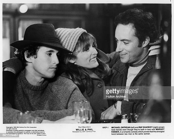 Michael Ontkean Margot Kidder and Ray Sharkey talk in a bar in a scene from the 20th Century Fox movie Willie Phil circa 1980