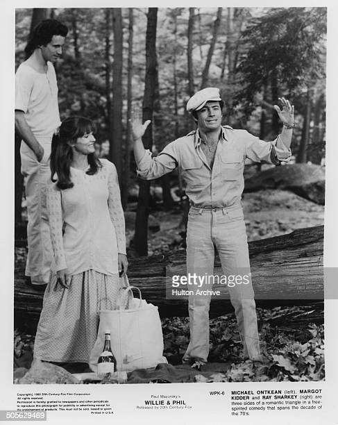 Michael Ontkean Margot Kidder watch Ray Sharkey in a scene from the 20th Century Fox movie Willie Phil circa 1980