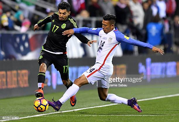 Michael Orozco of the United States battles for the ball with Jesus Corona of Mexico in the second half during the FIFA 2018 World Cup Qualifier at...