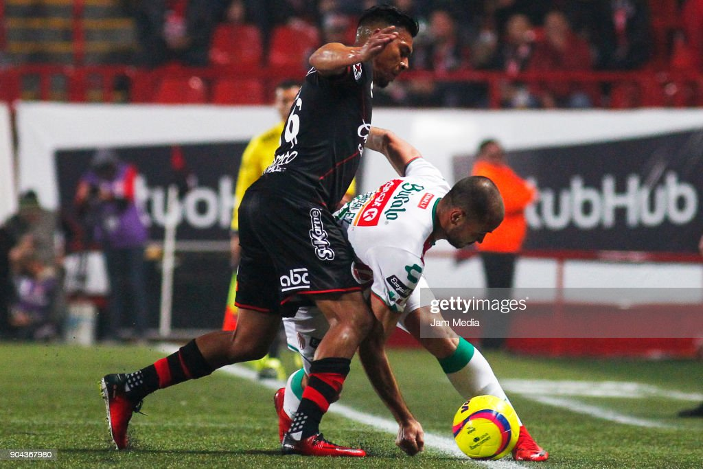 Michael Orozco (L) of Tijuana and Carlos Gonzalez (R) of Necaxa fight for the ball during the second round match between Tijuana and Necaxa as part of Torneo Clausura 2018 Liga MX at Caliente Stadium on January 12, 2018 in Tijuana, Mexico.