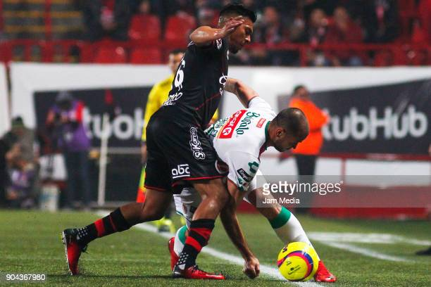Michael Orozco of Tijuana and Carlos Gonzalez of Necaxa fight for the ball during the second round match between Tijuana and Necaxa as part of Torneo...