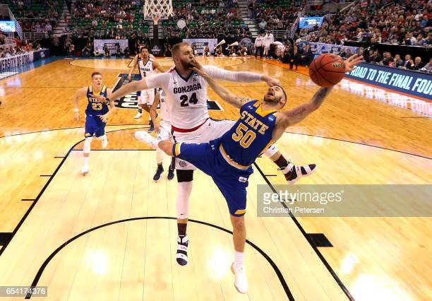 Michael Orris of the South Dakota State Jackrabbits drives to the basket against Przemek Karnowski of the Gonzaga Bulldogs in the second half during...