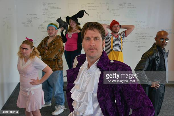 Michael Ortner front owner of software service company Capterra and his office workers wore Halloween costumes to work in the days leading up to...