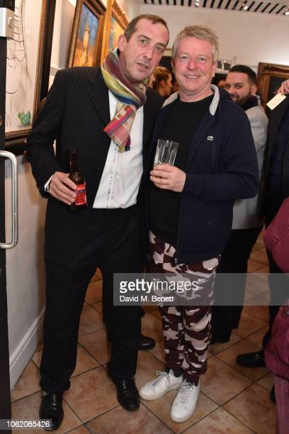 Michael O'Shea and John Burns attend a private view of artist Paul Karslake's exhibition at The Marylebone Gallery on November 15 2018 in London...